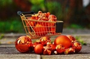Christmas shopping basket filled with baubles