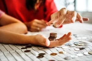 woman counting pennies