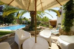 Spanish villa, table and chairs by the pool