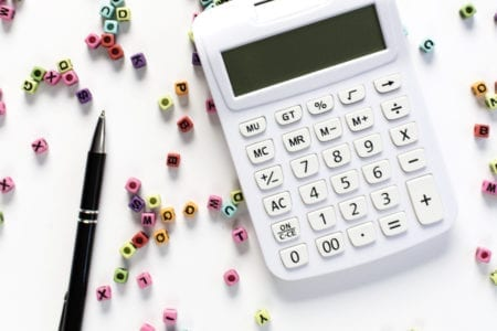 calculator and pen for budgeting