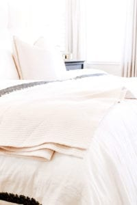 Bed with towel laid on