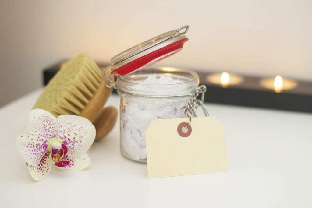 flower, bath scrub and candles