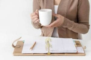 Woman working on budget with coffee