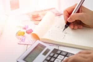Person working out finances and budget