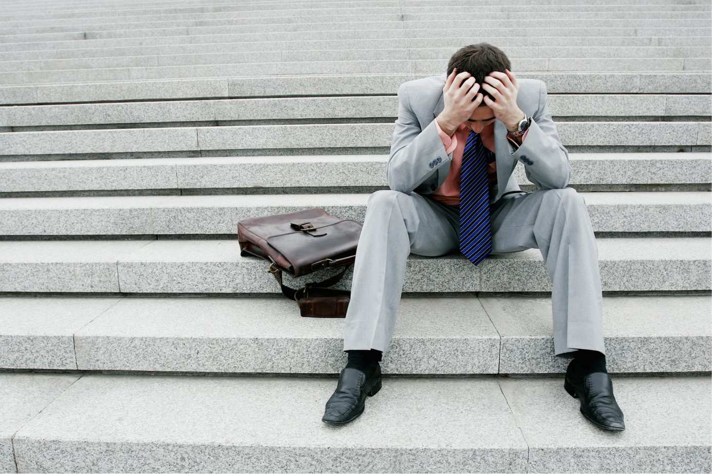 frustrated man sitting on steps