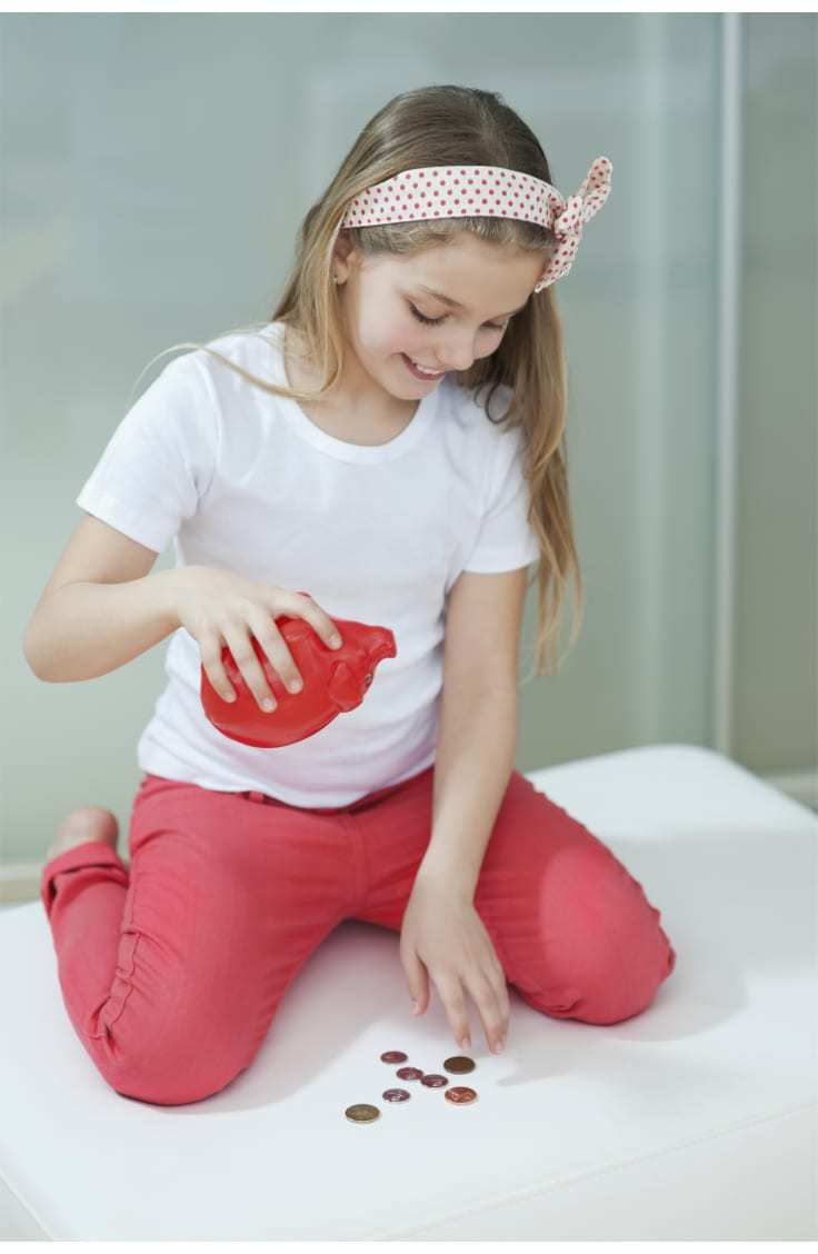 girl counting piggy bank coins