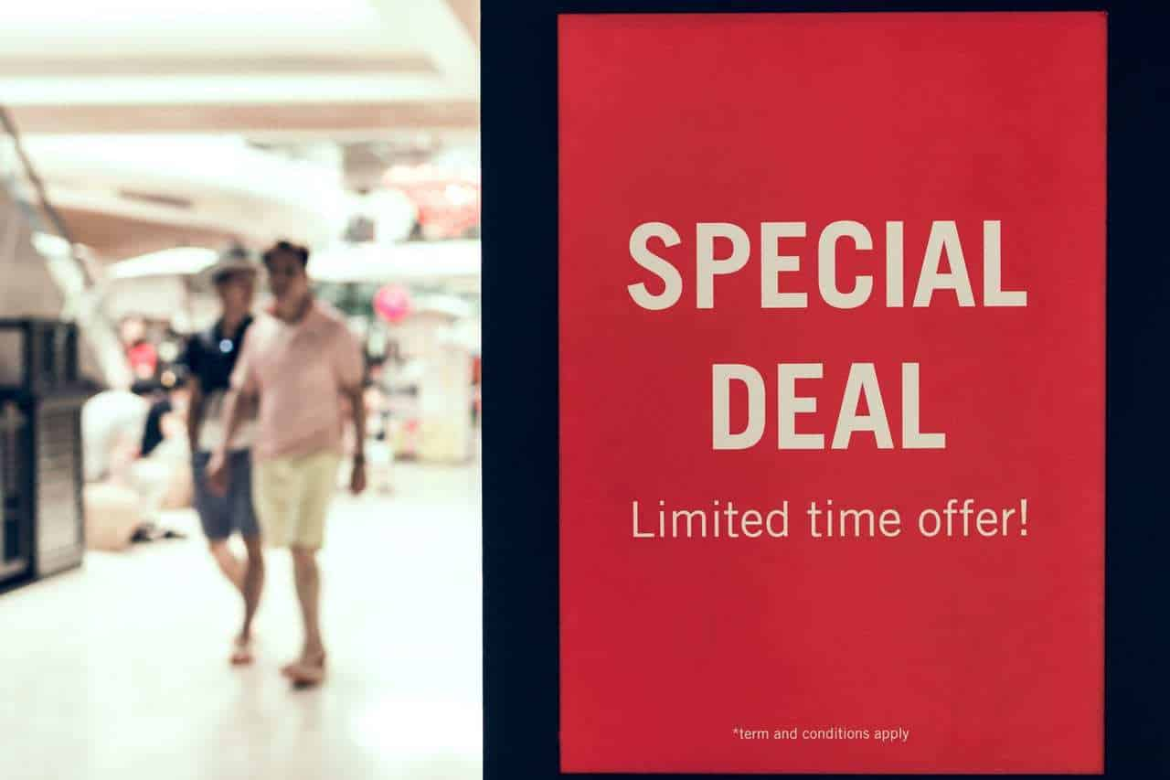 man wearing pink polo shirt with text overlay 'special deal'