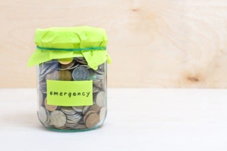jar of coins labelled 'emergency'