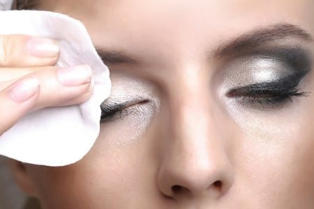 woman removing eye makeup