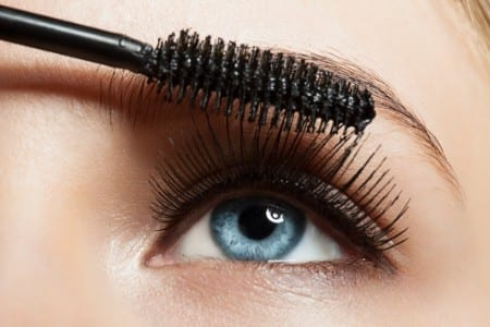 Woman's eye and mascara brush