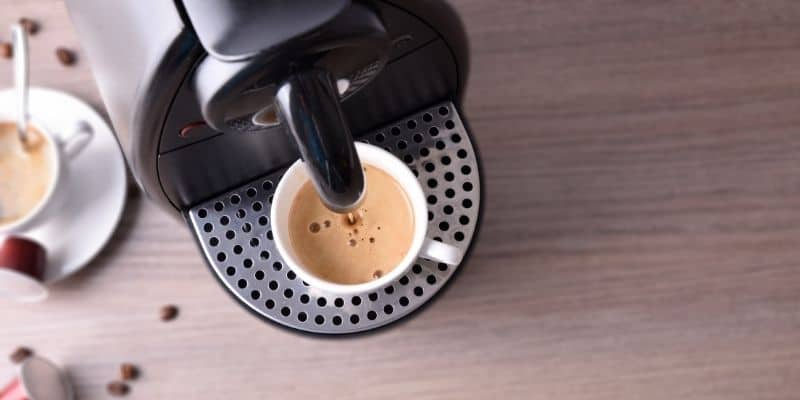 coffe macchine pouring cup of coffee