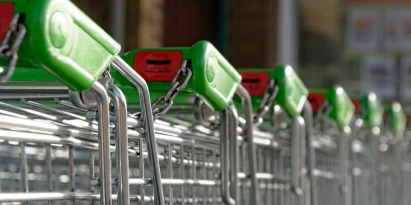 Row of empty chained together shopping trolleys
